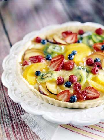 tarta de frutas fresas arandanos melocotones kiwis manzanas