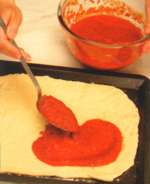 elaboracion pizza anchoas aceitunas