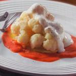 Coliflor con tomate y bechamel