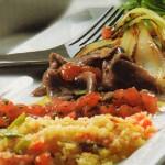 Verduras a la plancha con aceite de tomate, anchoas y cuscús
